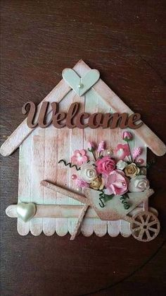 Awesome lollipop stick crafts for valentines Welcome house in Pink's and brown's with flowers and hearts. By CAM Lolly Stick Craft, Popsicle Stick Crafts For Adults, Ice Cream Stick Craft, Diy Popsicle Stick Crafts, Popsicle Sticks, Craft Sticks, Craft Stick Projects, Lollipop Sticks, Diy Home Crafts