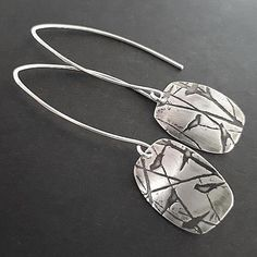 Measuring about 50mm long in total (2″), these handmade earrings have one of my own patterns with birds and trees on it.
