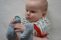 sew bells/buttons onto baby's sock when they become interested in their feet!