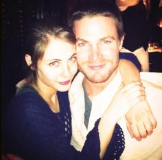 Willa Holland (Thea Queen) and Stephen Amell (Oliver Queen) on the set of Arrow.