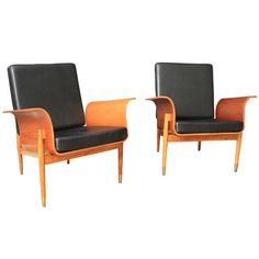 Pair of Mid-Century Modern Lounge Chairs | From a unique collection of antique and modern lounge chairs at http://www.1stdibs.com/furniture/seating/lounge-chairs/
