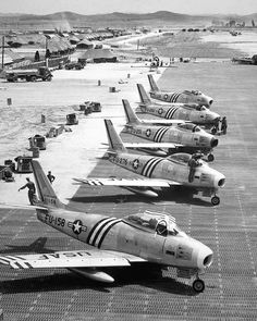 View of F-86 airplanes on the flight line getting ready for combat. June 1951. Air Force. (USIA)  Exact Date Shot Unknown