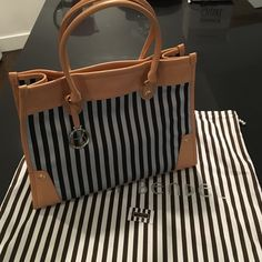 Henri Bendel brown and white stripe tote Used only a few times, in like new condition.  No signs of wear on the bag- inside and out.  Comes with original dust bag. henri bendel Bags Totes