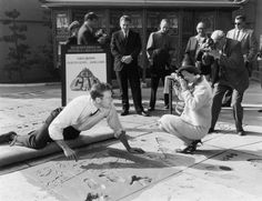 1962 Charlton Heston was invited to put his feet and hand-prints in cement in the courtyard at Grauman's Chinese Theater, Hollywood.