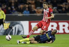 Miranda, the Inter Milan defender, times his challenge perfectly to stab the ball away from the advancing Rodriguez