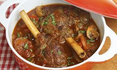 Slow cooker recipes are a busy mum's best friend. This easy slow cooker recipe combines the delicious flavours of lamb shanks and a rich tomato sauce to make a yummy warming casserole.