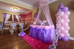 Balloon decor by front window and tulle with lights around table