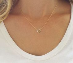 Bring some heart to your next look with our dainty gold necklace, with a stunningly gold filled heart charm. This delicate and dainty necklace is perfect for daytime wear. With its simple, open design, this goldfilled necklace is sure to compliment Small Heart Necklace, Dainty Gold Necklace, Cute Necklace, Simple Necklace, Heart Pendant Necklace, Heart Jewelry, Simple Jewelry, Jewelry Gifts, Jewelery