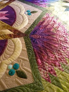 My goodness. How does one quilt something so spectacular? And how much of this is pieced? I can't even tell!