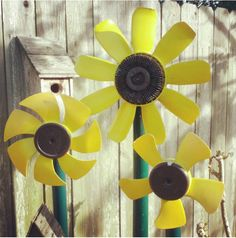 DIY recycled car part yard art sunflower flower