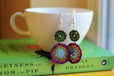 Brilliant colors bring to mind flowers, especially the flower markets of Europe. These intricate earrings are made up of two different sized motifs…