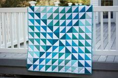 Going to the beach? This half-square triangle quilt pattern reminds us of ocean waves. Forget towels -- this gorgeous quilt is the picnic blanket of the future!