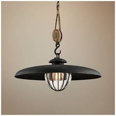 A rope and pulley suspension hangs a canopy and bulb cage frame in vintage farmhouse iron finish with this Troy Lighting pendant light. Game Room Lighting, Troy Lighting, Barn Lighting, Interior Lighting, Lighting Ideas, Pendant Light Fixtures, Pendant Lighting, Suspension Hanging, Old Bar