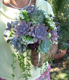 Succulent Wedding Bouquet... I wonder if you could then pot them after the wedding to keep them... cute.