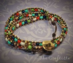 Multi colored beaded weave with large colored beads and smaller silver or gold beads