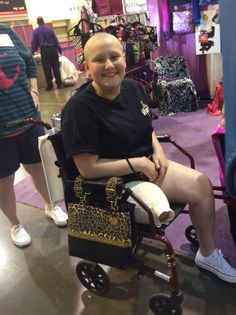 The Metro Leopard perfectly works around the smaller armrests of her device, and brings a killer smile to boot! (2015 Houston Abilities Expo)