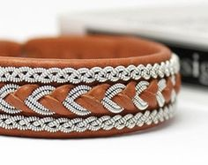 Sami bracelet in genuine leather Viking bracelet Saami bracelet Bracelet lapon saami armband cuff bracelet handmade in Sweden by AC Design Leather Cord, Cow Leather, Nordic Vikings, Viking Designs, Viking Bracelet, Handcrafted Jewelry, Handmade, Bracelet Making, Jewelry Collection
