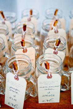 Mason jars filled with honey sticks doubled as guests' escort cards and favors. Wedding Table, Diy Wedding, Rustic Wedding, Wedding Gifts, Wedding Stuff, Wedding Ideas, Wedding Bells, Wedding Details, Summer Wedding