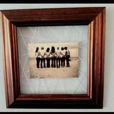 Old picture frame with string hot glued to the back