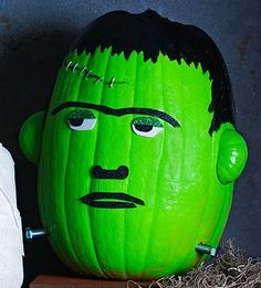 Friendly Frankenstein Pumpkin. Used spray paint and masking tape to section off the black hair. Used big roofing mails for the scar. Easy.