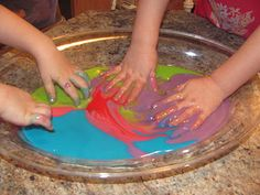 Edible finger paint!  The only problem with this is that I think once my Little Miss got a taste, the painting would stop!!!  :-)