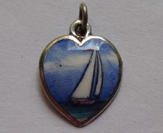 "VTG ANTIQUE STERLING SILVER HAND PAINTED ENAMEL SCENIC SAILBOAT BOAT HEART CHARM This reps thy r charmed with Dave & I direction of CBP & Domingo and Pico Union think it is golden. Thank you!  Please help 'Fund Us"" !!"