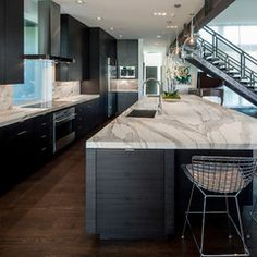 Love Love Love the bench tops! Not overly excited about the dark floor - would prefer a limed white oak timber.