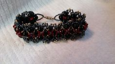 I made this 8 inch Red Swarovski crystal bracelet and black glass beads with TOHO seed beads. I also put a magnet for the closure.