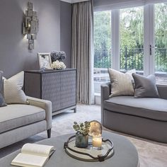 """Bedroom sitting room area with a bluey grey colour scheme"""