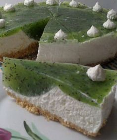 """Cheesecake with kiwi jelly - the recipe source looks suspect... looks like a recipe collection... and the recipe looks like translated, mostly by Babelfish or something like that. """"Cake with cheese and kiwi""""? But it sure looks nice. It would be nice to give credit to the original creator of this recipe and the photographer, but I suppose that's not going to happen."""