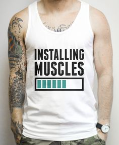 Installing Muscles on a White Tank Top Its time to install some muscles. It may take awhile, but its worth the wait in the end. Show off your funny side with this nerdy workout shirt at the gym! top, tank top, racerback, funny, retro, vintage, clothes, graphic, swag, dress, hipster, pink, girls, men, women, fitness, yoga, crossfit, lift, beast, sweat, gym, workout, weights, running, training, train, shoes, swole, muscles, diet, sale, body transformation