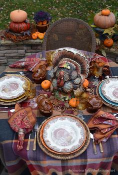 A plaid fringed throw provides a warm and colorful foundation in shades of purple, plum, terracotta and pumpkin for Thanksgiving table with colorful trimmings! Thanksgiving Countdown, Thanksgiving Greetings, Vintage Thanksgiving, Thanksgiving Table Settings, Thanksgiving Tablescapes, Thanksgiving Feast, Holiday Tables, Thanksgiving Decorations, Outdoor Thanksgiving