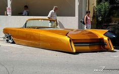 Obviously modified and lowered early 60s Cadillac DeVille convertible.