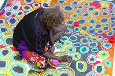 Senior artist Anne Hogan works 'en plein aire' on her portion of the 2012 women's collective painting Kungkurungkalpa Minyma Tjintirtjintir