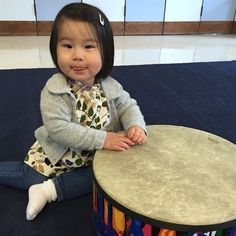 Someone loves to play the drum!  Looking oh so stylish in our Elise cardigan.