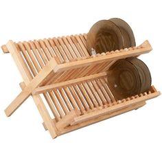 Doprava ke mě do Holešovic: 29 korun - do tý Uloženky dole. :) Dřevěný odkapávač na nádobí kvalitní kaučukové dřevo možno použít i jako stojan na talíře Odkapávač na nádobí je vyroben z vysoce kvalitního kaučukového dřeva. Dřevěný odkapávač na nádobí může sloužit i jako moderní stojan na talíře.  Materiál: kaučukové dřevo  Rozměry: 41,5 x 35 x 25 cm