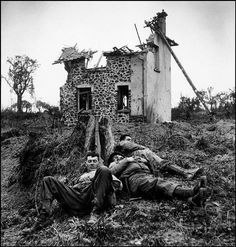 Robert Capa. American soldiers resting, near St. Lô, France], July 26-30, 1944