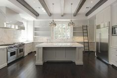 Dark floors, gray cabinets and gray/white Marble Countertops