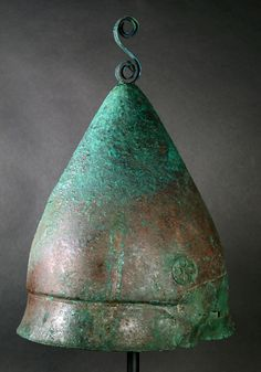 Greek Bronze Pilos Helmet, 4th Century BCThe Pilos helmet, takes its name from the felt shepherd's cap whose form it replicates. This helmet type came into use during the later Peloponnesian War,...