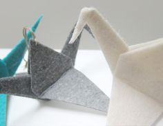 origami-inspired felt cranes for Christmas ornaments.  unfortunately no instructions.