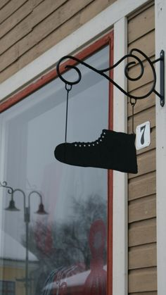 Vanhan Rauman kyltit | Shoemaker | Rauma | Finland Wooden Architecture, Fun Signs, Small Town Girl, Shop Fronts, Street Signs, Shop Signs, Cobbler, Old Houses, The Neighbourhood
