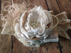 Stunning vintage style over the top headband made in rich champagne and ivory. Hand crafted with large satin rose petals, hand rolled rosettes, lace, pearls, satin, tulle, Rhinestones, lace and soft f