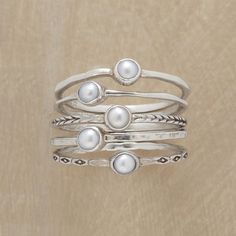 PEARL RING QUINTET, SET OF 5 -- Five cultured pearls are bezel set atop thread-thin silver bands, each different—polished, hammered and engraved. Handmade exclusively for Sundance. Whole and half sizes 5 to 9. Set of 5.