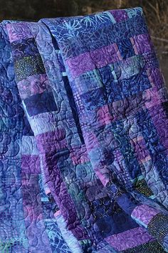 "This fun and strippy quilt in Spring-like colors is based on Laurie Shifrin's ""Bits & Bars"" pattern, and was made with a large selection of high-end blue and purple batik fabrics."