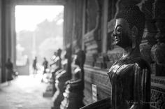 Black and White Buddha in Laos by NutdanaiSirinapanont