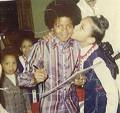 A fan giving Michael Jackson a kiss in the 1970s. Look at Michaels smile.
