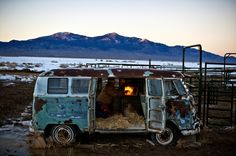 Dave Baker ignites a propane heater inside an old Volkwagen bus, preparing it as a shelter for the upcoming calving season.