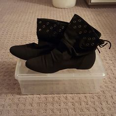 Black Booties Black faux leather Booties with gold gussets and a tie at the back heel, doesn't say a brand, I feel like it may be Steve Madden or something similar, size 37, have only been worn twice, like new condition Shoes Ankle Boots & Booties