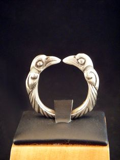 Sterling Silver Viking Torc Ring With Odins Ravens. Hand antiqued to show off carving. Can make any size. Handmade in our shop.