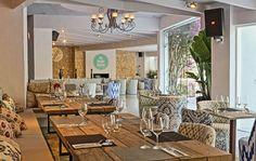 Inside dinner room - Boho inspiration - Balearic fabrics -  Mix and mach decoration  #balearic #woodtable #beautifulrestaurant #ibizastyle #cosyrestaurant #ibizaforever